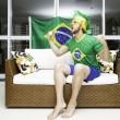 Brazilian supporter celebrates at home — Stock Photo #42882877