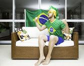 Brazilian supporter celebrates at home — Stock Photo