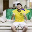 Brazilian supporter at home — Stock Photo