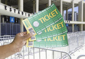 Hand holds soccer tickets in front of the Maracana Stadium — Stockfoto