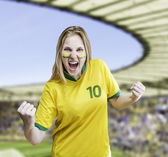 Brazilian woman celebrates on the stadium with her face painted — Photo