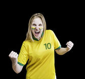 Brazilian woman celebrates on black background with her face painted — Photo