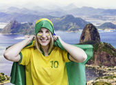 Woman holds a brazilian flag on Rio de Janeiro, Brazil — Stock Photo