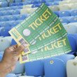Hand holds a homemade soccer tickets in the stadium - Brazil — Stock Photo #43434277