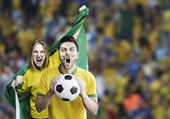 Brazilian couple celebrate on the stadium — Stock Photo