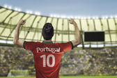 Portuguese soccer player celebrates with the fans on the stadium — Photo