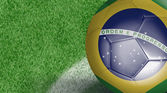 Amazing Soccer ball with Brazil flag isolated on field — Stockfoto