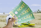 Hand holds a homemade soccer tickets on the beach — Foto de Stock