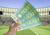 Hand holds a homemade soccer tickets in the stadium - Brazil — Stock Photo