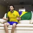 Brazilian supporter celebrates at home — Stock Photo