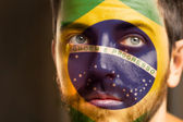 Brasileño pintada la bandera de brasil en su cara — Foto de Stock