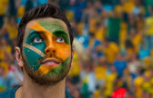 Brazilian painted the flag of Brazil on his face — Stock Photo