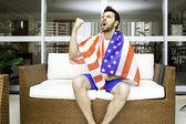 American fan celebrates at home — Stok fotoğraf