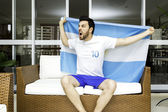 Argentine fan celebrates at home — Stock Photo
