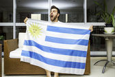 Uruguayan fan celebrates at home — Stock Photo