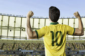 Brazilian soccer player celebrates on the stadium — Stock Photo