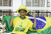 Brazilian fan boy with his face painted — Stock Photo