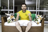Brazilian fan celebrates at home — Stock Photo
