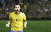 Jugador de fútbol brasileño celebra en el estadio — Foto de Stock
