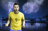 Brazilian fan celebrates the victory after the match — Stock Photo