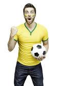 Brazilian fan celebrates on white background — Stock Photo
