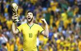 Brazilian soccer player celebrates holding a trophy - stadium — Stock Photo