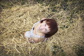 Woman on hay — Stock Photo