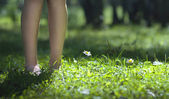 Feet in the grass — Stock Photo