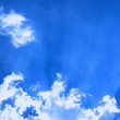 Stock Photo: Cloud with sun beams