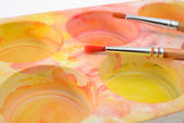 Palette with paintbrush — Stock Photo
