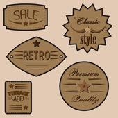 Set of vintage design labels and badges. — Stock Vector