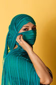 An attractive woman wearing head covering — Stock Photo