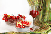 Still life with pomegranate and rowan — Stock Photo
