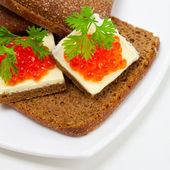 Red caviar appetizer — Stock Photo