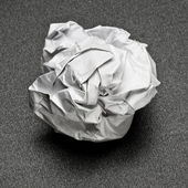 Crumpled paper on a gray table, the failure of unsuccessful proj — Stock Photo