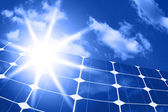 Solar panels with sun — Stock Photo