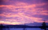 Beautiful sunset on a winter evening — Stock Photo