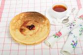Pancakes with jam and tea — Stock Photo