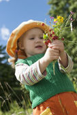 The little girl with wild strawberry — Stock Photo