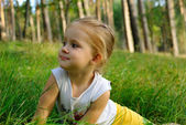 Portrait of the child on a grass — Stock Photo