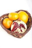 Oranges with pomegranate — Stock Photo