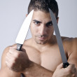 Stock Photo: Murderer of knives