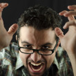 Angry man on black — Stock Photo