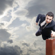 Flying businessman — Stock Photo