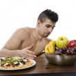 Stock Photo: Fitness man prefers fruit.