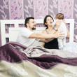 Stock Photo: Happy bedroom family