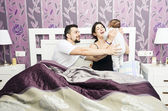 Happy bedroom family — Stock Photo
