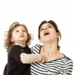 Mom and little daughter looking up - Stock Photo