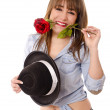 Girl with rose and hat — Stock Photo