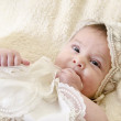 Cute baby with christening clothes — Stock Photo